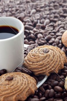 coffee with cookies - A dark coffee and coffee beans with cookies on the side