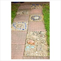 alternate paver and mosaic stepping stones for a garden path