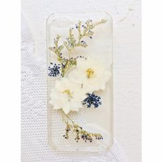 Pressed Flower iPhone 5/5s Case iPhone 5/5s Case. Clear plastic case with pressed flowers. Shipped in a secure iPhone case container (different brand). Slight wear and scratches (see photo). Accessories Phone Cases