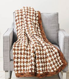 Nice cozy blanket done in two colors. 3 skeins of the dark yarn and 2 skeins of the lighter colored yarn. The striped mosaic, slipped stitch pattern is fun to do and creates a dramatic appearance.