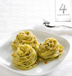PINENUT PASTA  Serves 2.  3 tbsp. butter  3/4 cup pine nuts  200g / 7 oz. spinach fettuccine  1/2 cup grated Parmesan cheese  Place the butter and pine nuts in a warm frying pan and cook, tossing, for 1 minute or until golden brown. Cook the pasta in a pan of boiling, salted water according to packet instructions. Drain, and toss pasta with the buttery pine nuts. Stir in the Parmesan and serve. Sprinkle with a little cracked pepper.