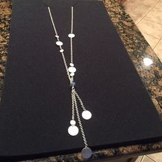 Necklace-long disc Lia Sophia Long sliver disc necklace ! Perfect with long sweater or short! Very pretty! Lia Sophia Jewelry Necklaces