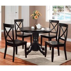 @Overstock - Home Styles' five-piece black dining table set is an elegant addition to any dining room. This beautifully crafted wooden dining set with a black finish offers a touch of sophistication with a cross-back design, while maintaining durability. http://www.overstock.com/Home-Garden/Home-Styles-Black-5-piece-Dining-Furniture-Set/6626642/product.html?CID=214117 $592.99