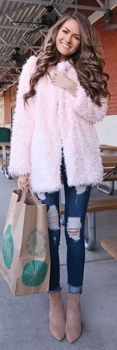 #winter #outfits pink fur coat and distressed blue denim jeans outfit
