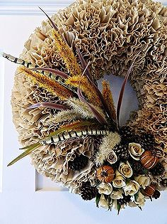 fall coffee filter wreath, christmas decorations, crafts, seasonal holiday d cor, wreaths, A couple of hours will get you a pretty spiffy and inexpensive new fall wreath Unbleached coffee filters a foam wreath and the decorations of your choice Pretty great results from a whole lotta nothin