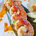 Chile-Garlic Shrimp ~Soooo low in carbs = yum! Serve w/ brown rice & broccoli - you still might have some carbs leftover for dessert! ~ These spicy sauteed shrimp are hard to resist. Calories - 160 Carbohydrates - 2.4g Fat - 5.5g Protein - 23.3 g