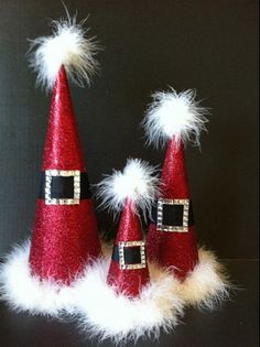 DIY: Santa Hat Cones. Feather boa, Red glitter scrapbook paper, wide black satin ribbon, and a jeweled square finding.