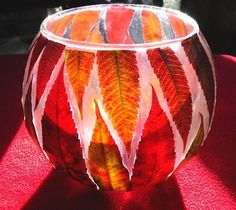 fall foliage candle:) all you need is bright leaves (pressed for a few days), a cheap glass jar or bowl, and Mod Podge glue!