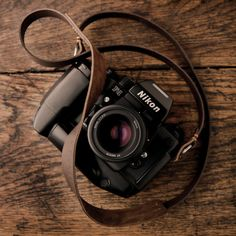 Nikon with our handmade leather camera neck strap. Nikon Camera Tips, Camera Hacks, Camera Nikon, Camera Gear, Film Camera, Camera Wrist Strap, Leather Camera Strap, Leather Case, Stylish Camera Bags