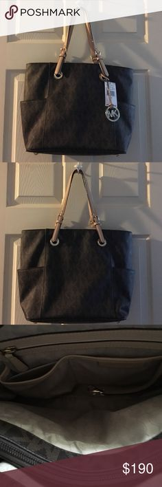 MICHAEL KORS MICHAEL JET SET SIGNATURE TOTE MICHAEL MICHAEL KORS JET SET EAST WEST TOTE. Comes with care instructions and dust bag. Took tag off never used. NWT 16 X 11 X 6. MICHAEL Michael Kors Bags Totes