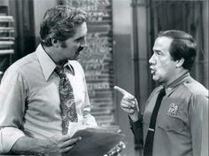 """1978 Press Photo Hal Linden and Ron Carey in """"Barney Miller """"The Baby Broker"""" 1980 Tv Shows, Hal Linden, Barney Miller, Press Photo, Floral Tie, Ol, Baby, Fictional Characters"""