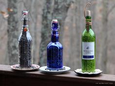 the garden-roof coop: DIY Wine Bottle Bird-Feeders