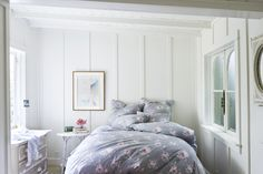 Bedroom Envy. Grey and floral bedding in a sunlit room.