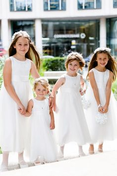 Real wedding: Classic elegance in London | Flowergirl dresses The four flowergirls wore white dresses and shoes from John Lewis. They each carried a floral pomander that Karen's mother hand made.