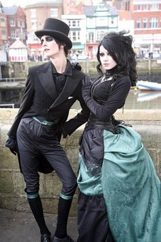 I am in love with everything in this picture! Seriously, couldn't get any better. The dress/corset are perfect, the hair, the makeup, the guy, the clothes he's wearing... SO HOT!