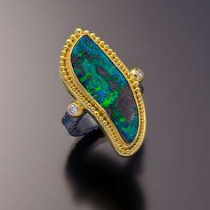 Oxidized sterling silver 22kt gold boulder opal ring by Zaffiro Fine Jewelry.   via zaffirojewelry.com