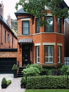 Urban Victorian Front Yard. Black door & trim with brass.
