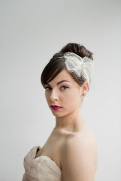 Elina antique chantilly lace hair bow by Emici Bridal.