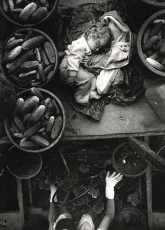 Baby on Cucumber Machine, Kent County, Ontario, Canada, 1996. • Larry Towell