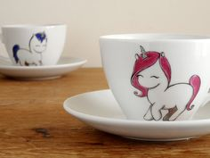 Valentine's gift His&Hers unicorn coffee mugs and by vitaminaeu, €35.00  OMG soooo cute.  I think John would think its too much lol  It has rainbow saucer that comes with it.