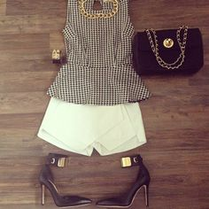 Gingham peplum and pastel shorts. Preppy or high fashion: can't tell.