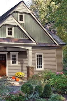CraneBoard Vinyl Siding with metal transitions - five distinct colors look great together (stone, horizontal vinyl, metal (bronze?), vinyl board & batten, white on posts and up top)