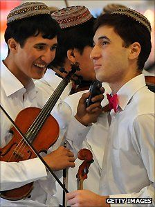 Musicians chat before playing. Turkmenistan.