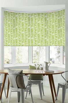Bring Greenery Pantone Colour of the Year 2017, with bright patterns and accessories within a lovely simple decor of white and natural wood tones. Our Stem Green Roller blinds is perfect for this room.