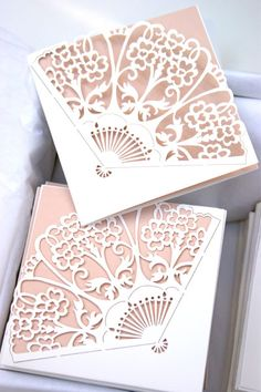 Laser cut vintage fan wedding invitations, cut on to silk & finished with a nude inlay.