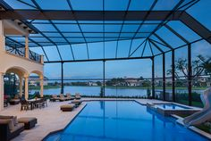 Two story pool enclosures with picture windows Pool Screen Enclosure, Screen Enclosures, Pool Enclosures, Screened Pool, Two Story Windows, Tropical Design, Second Story, Lanai, Pool Houses