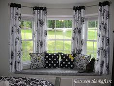 I love the spacing of the curtains for the bay window. I also love the way the cushion and pillow match (different design but same colors & just a touch of yellow). between the rafters | Between the Rafters: Do It Yourself Bay Window Curtain Rod Tutorial