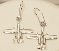 This is a solid cast pair of sterling silver earrings of the Republic, A-10 Thunderbolt II, affectionately known as the Warthog, which is the awesome tank killer of the U.S. Air Force. It was the very last airplane designedRepublic Aviation, and what a swan song it was! First flown in 1972 and used extensively in the Gulf Wars and Afghanistan, it is still out there flying today, after more than 45 years of continued service. WOW!     As with all of my airplane jewelry, the master model…