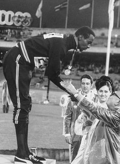 American athlete Bob Beamon receives the Gold Medal for the Long Jump at the 1968 Summer Olympics in Mexico City, October He had set a world record for the event with a leap of 29 ft, in. 1968 Olympics, Summer Olympics, Long Jump, High Jump, Olympic Icons, American Athletes, Triple Jump, Pole Vault, Olympic Athletes