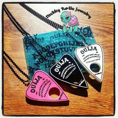 Hey, I found this really awesome Etsy listing at https://www.etsy.com/listing/217948995/ouija-planchette-resin-charm-necklace