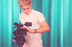 GIF - Niall videotaping, he looks so focused