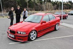 Hellrot BMW e36 sedan on OEM BMW Styling 21 (Throwing star) wheels