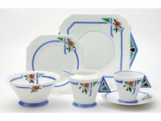 A 1930s Shelley Art Deco tea set, each piece decorated with the 11755 pattern of an orange, with leaves breaking the continuity of a sky blue rim band, comprising milk jug, sugar bowl, sandwich plate, four cups, five saucers and six tea plates.