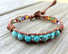 Turquoise knotted bracelet with hamsa charm door DESIGNbyANCE