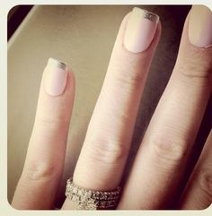 Pale pink nails with silver tips