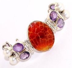 "Mexican Fire Agate - Amethyst - Pearl - .925 Sterling Silver Toggle Bracelet ,Length:6 3/4"" - 7 3/8"" - 7 7/8"" A4 Silverinvasion Jewelry. $99.95. MEXICAN FIRE AGATE - AMETHYST - PEARL - .925 Sterling silver bracelet. Width : 1 1/4"" ( 35 mm ). Ships in black velvet bracelet box. Total Weight: 47.8 Grams. Length : 6 3/4"" - 7 3/8"" - 7 7/8"" ( 17 - 18.5 - 20 cm )"