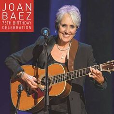 I just used Shazam to discover Oh Freedom/Ain't Gonna Let Nobody Turn Me Around by Joan Baez. http://shz.am/t320120779