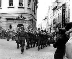 Nazi band marching up the High Street of St Peter Port, Guernsey - c. 1940.