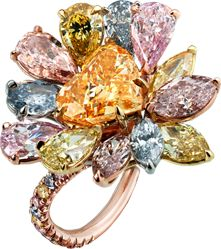 FANCY COLORED DIAMONDS FANCY VIVID ORANGE DIAMOND RING Heart-shaped Fancy Vivid Orange diamond mounted with seven pear and five marquise-shaped multi-colored diamonds and highlighted by pink, yellow and blue pave diamonds, handcrafted in platinum and 18 karat pink and yellow gold