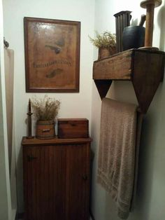 Upside Down Tool Box...re-purposed into a prim towel holder. Love this!!