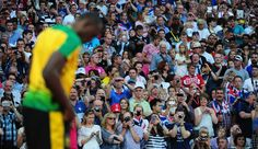 In This Photo: Usain Bolt -  The crowd cheers as Usain Bolt of Jamaica looks on after competing in the Men's 200m Semifinals on Day 12 of the London 2012 Olympic Games at Olympic Stadium on August 8, 2012 in London, England.  (August 7, 2012 - Source: Stu Forster/Getty Images Europe) - http://www.PaulFDavis.com/success-speaker (info@PaulFDavis.com)