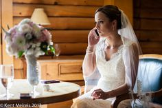 Bride talking with her grandfather on the phone after getting ready for her ceremony at a Keystone Ranch Wedding.