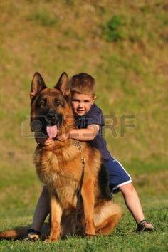 Happy Smiling Little Boy Hugging His German Shepherd