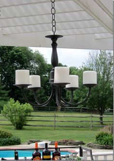 """DIY outdoor candle chandeler by Diane from """"In My Own Style.""""  This started out as one of those ugly gold chandeliers you see in thrift stores all the time!"""