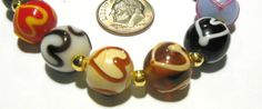 SOLD! 9 Handmade Glass Lampwork Beads . Starting at $5 on Tophatter.com!