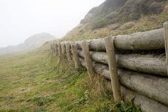 An old fashioned wooden log fences separates a green mountain Stock Photo - ...    123rf.com